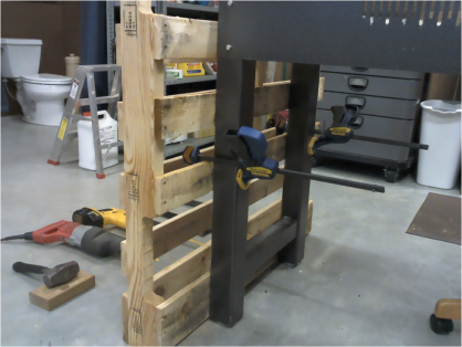 Clamps hold the pallet to a worktable so this can be a one-person job.
