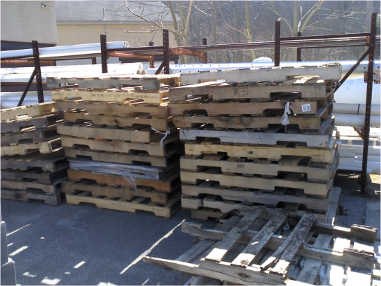 Used pallets behind the hardware store.