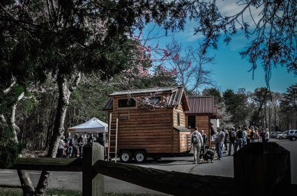 Tiny houses and people lined up to tour them.